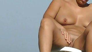 Sexy amateur hidden beach cam video on the nudist beach Thumbnail