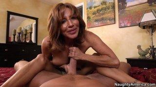 POV video of mature mommy Tara Holiday giving blowjob and footjob Thumbnail