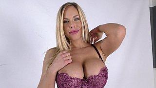 Busty blonde in stockings taking black Thumbnail